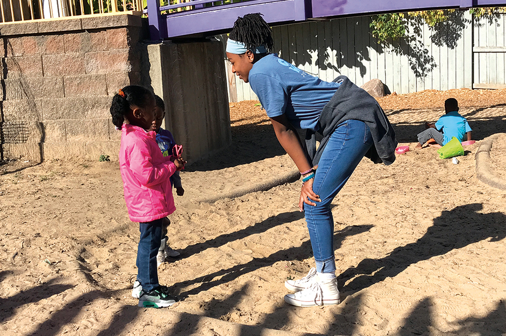 Crossroads students volunteer with young children on Good Work day