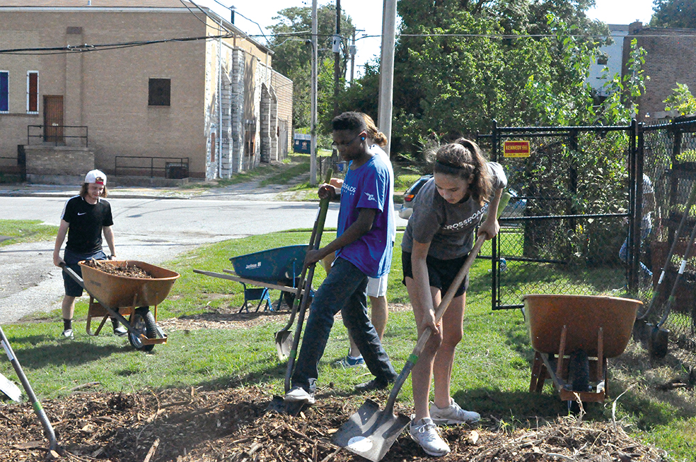 Crossroads students help create new gardens in the city on Good Work day
